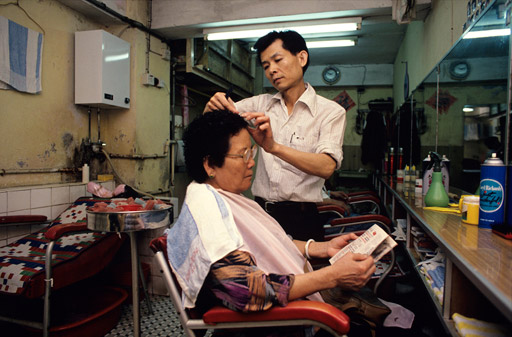 Ho Chi Kam, owner of a hairdressing salonon Tai Chang street