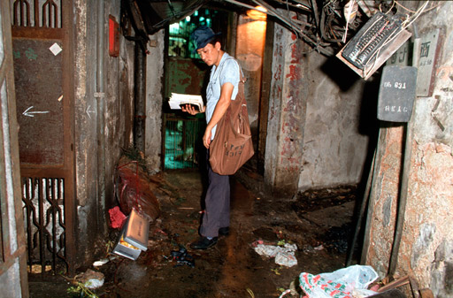 Mr Lui, the Walled City's most experienced postman