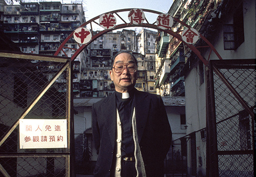 Reverend Liu outside the Old People's Centre in the yamen courtyard.